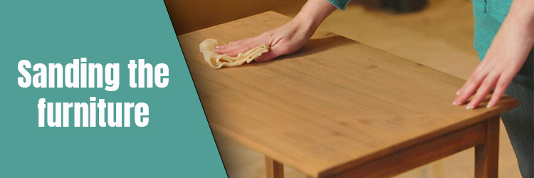 Sanding the furniture