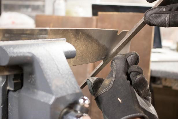 how to sharpen lawn mower blades: Clamp and File